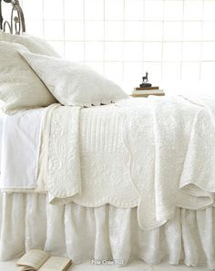 white layers of bed linens - beautiful