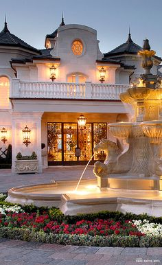 French chateau style driveway with fountain