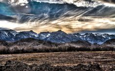 On my way to Lake Tahoe, I pulled over on the side of the highway to snap this one of Mt. Whitney. The sunset behind the mountain range was gorgeous and it was worth the detour. I took 3 photos to produce this HDR shot. Mount Whitney is the highest summit in the contiguous United States and the Sierra Nevada, with an elevation of 14,505 feet.