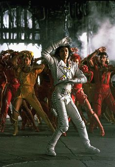 Captain EO.  I was there at Disneyland the opening weekend when Captain EO first came out.  It was soooo cool.  There was a parade with lots of celebrities and we got to see lots of them walking around Disneyland.  I think I was about 18 then.  Such a fun trip.