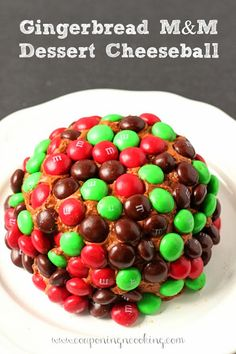 A gingerbread twist on a traditional dessert cheeseball, topped with Gingerbread M&M's it's the perfect holiday dessert! www.CouponingNCooki...