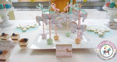 Check out these amazing cake pops at a carousel baptism party! See more party planning ideas at CatchMyParty.com!