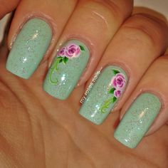 Mint with floral water decals    http://myrosesnails.blogspot.com/2015/06/mint-with-floral-water-decals.html