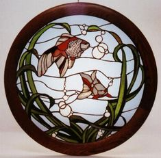 ornamental goldfish http://www.panedexpressions.com/stained-glass/stained-glass-nature.html