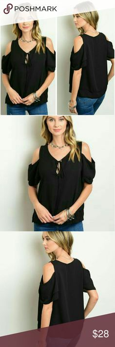 "Short sleeve black cold shoulder blouse  S, M, L Gorgeous black short sleeve cold shoulder blouse. A little ruffle on the sleeves, v neck line with a tie string for detail. Made in the USA. Smooth 100% polyester. Not sheer or see through. Brand new with our boutique tag.  Available:   Small 7/8 Bust 36"" Length 24""                    Medium 9/10  Bust 38"" Length 24""                    Large 11/12 Bust 40"" Length 24"" Boutique Tops Blouses"
