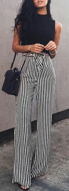 These pants are one of the truly spectacular garments this season. I covet them and I have been searching!  I guess I should describe them: they are high waisted wide trousers with  a black and white vertical striped print.  Self waist tie. Shown here with a black sleeveless top. Style Planet
