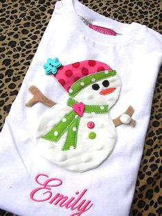 A whimsical layered Frosty the Snowman using all the designer fabrics you love. He is super soft with a minky body and designer hat and scarf. Plus all the precious embellishments to make him the hit of the holiday season. This design is hand drawn by our resident artist and is