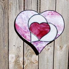 I love you, I love you more, I love you most - Valentine Stained Glass Suncatcher. $40.00, via Etsy.