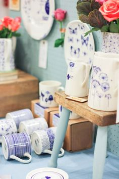 A painted stool makes a clever addition to this craft fair display at the Weekend of the Maker