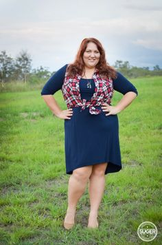 I'm a yes to a plaid vest | www.sugercoatit.com| plus size navy dress + red plaid outfit
