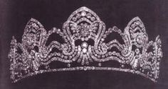 This is the only photo I can find of this tiara, which according to those in the know at Alexander palace, is a Hapsburg tiara. Designed as five large diamond motifs, which include a lot of sprays and scrolls and linked together with undulating lines of diamonds.