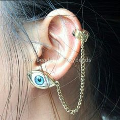 ♢PRICE DROP♢Golden Blue Evil Eye CuffLink Earrings Set of two golden trimmed evil blue eye cuff and chain linked earrings, in perfect condition and really cool! they will get noticed at every turn.   ✔ price always negotiable ✔ I will bundle Jewelry Earrings