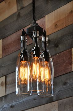 Awesome gothic style wine bottle hanging chandelier. This is made with three clear wine or water bottles, but any bottles can be used.