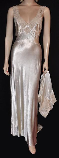 1930s Crepe-Back Satin 'Hearts' Nightgown and Matching Panty. The gown features both front and back plunging necklines.  It has rows and circles of satin hearts appliqued onto the lace bodice and the legs of the panty.  Probably custom made.  Via Silver Screen Loungerie.