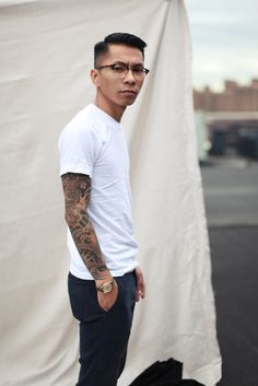similar to brandt look, but love the nice pants, the watch, the sophisticated eyewear and the minimalist professional-but-modern haircut