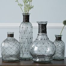 Wrapped in wire, our Wire Bottle Bud Vases are equally delicate and strong in character. Divide a simple bouquet among one or several for an instant, charming display. Tall Vases, Bud Vases, Flower Vases, Flowers, Vintage Jars, Tree Sculpture, Bottles And Jars, Mason Jars, Wire Crafts