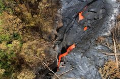 2014: The Year in Volcanic Activity - In Focus - The Atlantic     September 1, a closer look at the stream of lava from Kilauea, pouring into a deep ground crack. (Tim Orr/USGS HVO)