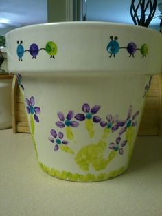 Mothers Day flower pot art! Handprint flowers of all the kids :)