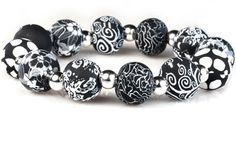 Viva Beads chunky silver ball bracelet in the Black Lace pattern.  Striking and easy to wear - this is a stretchy bracelet made of black and white polymer beads.
