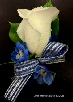 One of the beautiful custom dance or wedding boutonnieres designed by Lee's Corner Floral. Learn more or order yours today at leesmarketplacefloral.com