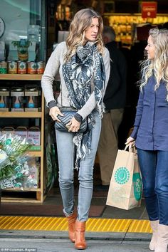 Gisele Bundchen wearing Chanel Chevron Flap Bag with Pyramid Clasp and Rag & Bone Newbury Booties