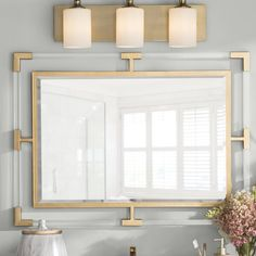 Willa Arlo Interiors This Rectangle Accent Mirror can certainly serve as a focal point for any room. Combining hand forged iron, finished in lightly antiqued gold leaf, with suspended solid, clear acrylic bars creates a modern feel. Contemporary Wall Mirrors, Modern Contemporary, Wall Mirror Online, Wall Mounted Mirror, Gold Wall Mirror, Gold Mirror Bathroom, Mirror Mirror, Beautiful Mirrors, Beautiful Bathrooms