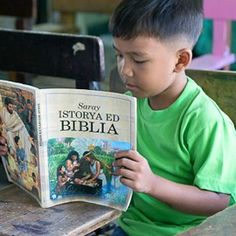 A young boy reading My Book of Bible Stories in Pangasinan...my great-grandson will search for his book and make me find his favorite pics for an hour or more almost every time he visits me., his favorite is Moses in the basket, not the one on the cover but the one inside!..? he's 22months old.