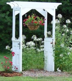 Repurposed Doors into an Arbor. Great idea. #repurposeddoor #recycle #doors #arbor