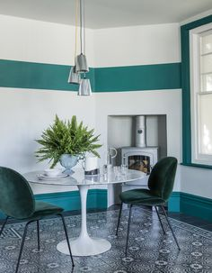 Colour block dining area. All white walls with strips of aqua green and a marble dining table. More paint ideas at http://www.redonline.co.uk
