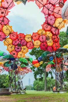 Organic Growth: A Large Pavilion Constructed out of Broken Umbrellas and Bicycle Wheels