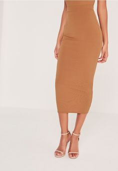 Keep it simple, babe. This ribbed midi skirt is the perfect mix and match piece…