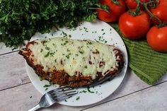 I've been making stuffed eggplant for years. This time around I decided to make it into a stuffed Eggplant Parmesan. Enjoy!