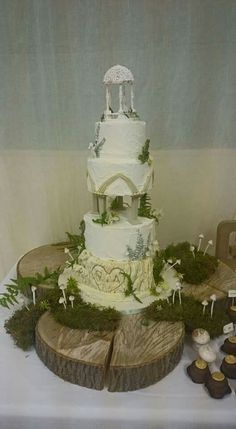 Lord of the rings inspired, woodland wedding cake. With furn, mushrooms and tree trunk effect base