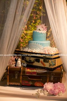 Tiffany Blue Wedding Cake with White Lace on Vintage Luggage