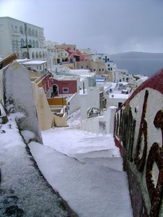"Snow in Santorini, Greece ""Hi ho hi ho, down the Caldera path we go"""