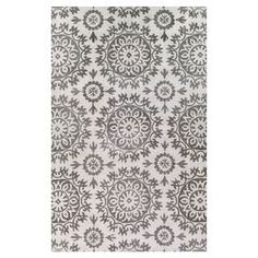 Hand-tufted virgin wool-blend rug with medallion motif.  Product: RugConstruction Material: Wool and viscoseColor: Ivory and taupeFeatures: Hand-tuftedNote: Please be aware that actual colors may vary from those shown on your screen. Accent rugs may also not show the entire pattern that the corresponding area rugs have.Cleaning and Care: Regular vacuuming and spot cleaning recommended