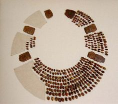 Early Bronze Age Amber necklace from 'Golden Barrow' at Upton Lovell. One of the richest Bronze Age burials yet discovered in Wessex, it may have been the grave of a woman. The central piece was this necklace formed from hundreds of amber beads.
