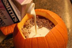 Stuffed Pumpkin Bake - ground beef or sausage, rice and heavy cream combine with herbs and spices for a yummy fall meal. And best of all, se...