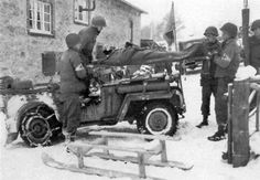 Medical personnel attached to the 119th Infantry Regiment (30th Inf Div) transfer casualties from an Ambulance Jeep to an Aid Station. Note ...