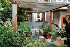 A cozy pergola covers this seating Minneapolis backyard seating area. Photo by Alex Steinberg