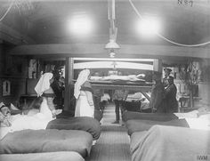 A patient being lowered by lift into a ward on a hospital barge near Aire, 14 February 1918.