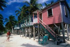 Colourful waterfront accomodation on the beaches of Caye Caulker, Belize. www.pinterest.com/wildcasalmon