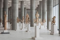 Acropolis Museum by Bernard Tschumi Architects. Nice minimal setting of columns and statues