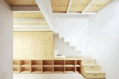 Arquitectura-G have recently completed this renovated interior for an apartment in El Born, Barcelona. A plywood mezzanine has been added to create a… Plywood Interior, Interior Stairs, Plywood Furniture, Interior Architecture, Plywood Bookcase, Barcelona Architecture, Low Bookcase, Furniture Storage, House Furniture