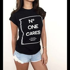 "No One Cares T-Shirt  No One Cares/ Paris Couture Tee.  Black with white lettering.  Small:  Bust 34.65"". Length: 24.80""      Medium:  Bust 36.22""  Length: 25.20"".  **NEW in package**  #5B487 523 Boutique Tops Tees - Short Sleeve"