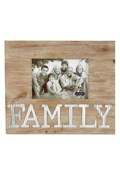 """Stained pine wood frame features dimensional corrugate tin""""FAMILY"""" sentiment. Holds 5"""" x 7"""" horizontal photo. Hangs on wall with sawtooth hardware or stands with dowel easel. Overall Size 11"""" x 13"""".   Family Frame by Mud Pie. Home & Gifts - Home Decor - Frames New Jersey"""