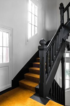 The black staircase by Black Stair Railing, Black Staircase, Stair Banister, Maison Nordik, Black Painted Stairs, Black Hallway, Painted Staircases, Flur Design, Hallway Inspiration