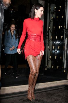 In a Ben Taverniti x Unravel Project dress and corset with AnneliseMichelson earrings and Balmain boots while out in Paris