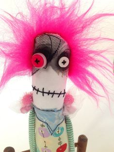 This is an upcycled art doll, made of a variety of fabrics and stuffed with fiber fill and sand, to give it a pleasant weight. Body approx. 11 inches