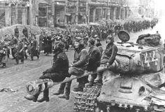 Soviet IS-2 tank crew watch a column of surrendered German troops in Berlin. Berlin, 1945  ~ Vengeance_Lord